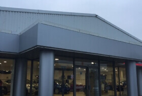 Painting of Curtain Walling & Cladding in Exeter Devon